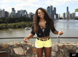Serena Williams of the United States poses with the Brisbane city in the background for photo session at Brisbane International tennis tournament in Brisbane, Australia, Sunday, Jan 1, 2012. (AP Photo/Tertius Pickard)