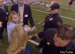 ESPN reporter Holly Rowe shoves another reporter to get an interview with Michigan coach Brady Hoke.