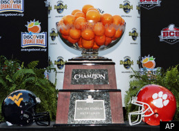 Clemson head coach Dabo Swinney talks to reporters before a news conference for the Orange Bowl NCAA college football game in Hollywood, Fla., Wednesday, Dec. 7, 2011. The game is scheduled for Jan. 4, 2012. (AP Photo/Alan Diaz)