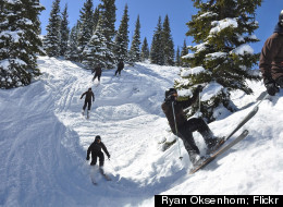 Skiers glide through the mountains at Ski Cooper.
