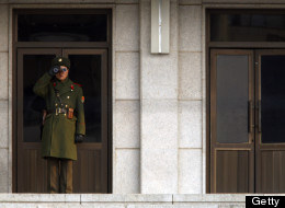 A North Korean soldier watches the South Korean side at the border village of Panmunjom in the DMZ, demilitarized zone in Panmunjom on December 28, 2011. The funeral ceremony for the late North Korean leader Kim Jong-Il started in Pyongyang, reported the ITAR-TASS news agency, the only Russian media with offices in the reclusive country. AFP PHOTO / POOL (Photo credit should read WALLY SANTANA/AFP/Getty Images)