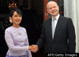 Myanmar democracy icon Aung San Suu Kyi (L) shakes hands with British Foreign Secretary William Hague ahead of a meeting at the British ambassador's residence in Yangon