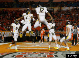 MIAMI GARDENS, FL - JANUARY 04: Tavon Austin #1 and Geno Smith #12 of the West Virginia Mountaineers celebrate after Austin caught a 37-yard touchdown reception thrown by Smith in the third quarter against the Clemson Tigers during the Discover Orange Bowl at Sun Life Stadium on January 4, 2012 in Miami Gardens, Florida. (Photo by Mike Ehrmann/Getty Images)