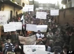 This image made from amateur video and released by Shaam News Network Tuesday, Jan. 3, 2012, purports to show Syrians chanting slogans during a demonstration in Hama, Syria. (AP Photo/Shaam News Network via APTN)
