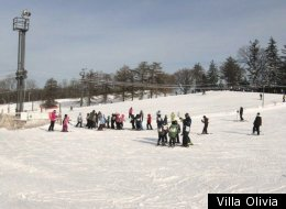 Skiers huddle up at Villa Olivia.
