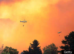 Helicopters fight a massive forest fire affecting the commune of Quillon, in southern Chile's Bio Bio region, on January 3, 2012. (Getty)