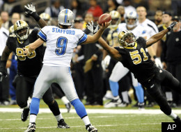 Detroit Lions quarterback Matthew Stafford (9) is pressured by New Orleans Saints middle linebacker Jonathan Vilma (51) and defensive tackle Sedrick Ellis (98) during the second quarter of an NFL football game in New Orleans, Sunday, Dec. 4, 2011. (AP Photo/Bill Feig)