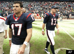 Houston Texans quarterbacks Jake Delhomme (17) and T.J. Yates (13) leave the field after a 23-22 loss to the Tennessee Titans in an NFL football game on Sunday, Jan. 1, 2012, in Houston. The Titans defeated the Texans 23-22. (AP Photo/Dave Einsel)