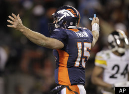 Denver Broncos quarterback Tim Tebow (15) reacts after throwing an 80-yard touchdown pass to wide receiver Demaryius Thomas (88) for the game winning touchdown against the Pittsburgh Steelers in overtime of an NFL wild card playoff football game Sunday, Jan. 8, 2012, in Denver. (AP Photo/Joe Mahoney)