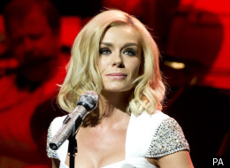 Katherine Jenkins is comforted by the conductor on her first concert appearance since splitting from fiance Gethin Jones