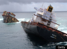 TAURANGA, NEW ZEALAND - JANUARY 9: In this handout provided by Maritime New Zealand, MV Rena is seen in two pieces after overnight bad weather pounded the vessel, on January 9, 2012 in Tauranga, New Zealand. Floating containers and debris have been found northwest of the vessel and more is expected to wash ashore today. Rena struck Astrolabe Reef off the coast of Mt Maunganui on October 5, 2011 and has spilled 350 tonnes of oil, and almost 100 shipping containers. (Photo by Maritime New Zealand