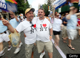 Joe Bednar (R) and Phil Mason look on during the Gay Pride parade on June 26, 2011 in New York City.