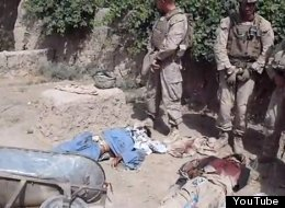 The video depicts what appears to be four Marines urinating on the bloodied corpses of Taliban fighters