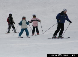 A ski instructor at Glen Eden leads a children's lesson.