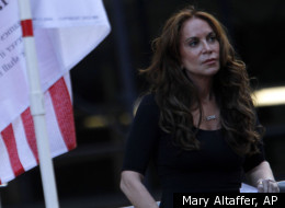 Pamela Geller listens to a speaker during a protest held in opposition to a proposed Islamic community center two blocks from the World Trade Center site,  Saturday,  Sept. 11, 2010 in New York. (AP)