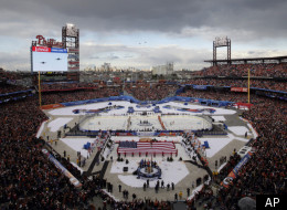 The New York Rangers and the Philadelphia Flyers line up for the national anthem and fly over before the NHL Winter Classic hockey game, Monday, Jan. 2, 2012, in Philadelphia. (AP Photo/Mel Evans)