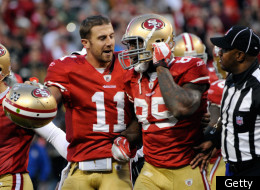 SAN FRANCISCO, CA - JANUARY 14: Vernon Davis #85 of the San Francisco 49ers reacts with Alex Smith #11 after his touchdown in the fourth quarter of the NFC Divisional playoff game against the New Orleans Saints at Candlestick Park on January 14, 2012 in San Francisco, California. (Photo by Thearon W. Henderson/Getty Images)