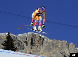 Lindsey Vonn, of the United States, takes a jump during an alpine ski, women's World Cup downhill, in Cortina D'Ampezzo, Italy, Saturday, Jan. 14, 2012. Vonn finished in second place. (AP Photo/Alessandro Trovati)