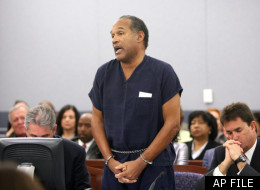 O.J. Simpson speaks during his sentencing hearing at the Clark County Regional Justice Center in Las Vegas, Friday, Dec. 5, 2008. Sitting right to Simpson is his lawyer Yale Galanter.