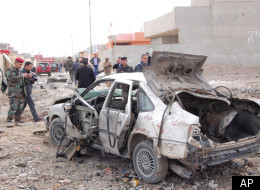Iraqi security forces inspect the scene of a car bomb attack outside the northern city of Mosul, 225 miles (360 kilometers) northwest of Baghdad, Iraq, Monday, Jan. 16, 2012. (AP)