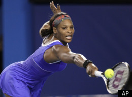 Serena Williams of the United States returns a ball to Tamira Paszek of Austria during their first round match at the Australian Open tennis championship, in Melbourne, Australia, early Wednesday, Jan. 18, 2012. (AP Photo/John Donegan)