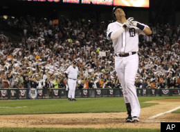 Detroit Tigers designated hitter Victor Martinez reacts at home plate after scoring on a solo home run in the fourth inning of Game 3 of baseball's American League championship series against the Texas Rangers, Tuesday, Oct. 11, 2011, in Detroit. (AP Photo/Charlie Riedel)
