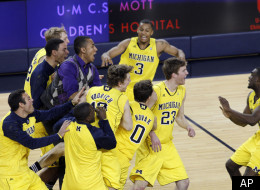 Michigan guard Zack Novak (0), forward Evan Smotrycz (23), and guard Matt Vogrich (13) celebrate with teammates including guard Trey Burke (3) and guard Tim Hardaway, Jr., right, after an NCAA college basketball game against Michigan State, Tuesday, Jan. 17, 2012, at Crisler Center in Ann Arbor, Mich. Michigan won 60-59. (AP Photo/Tony Ding)