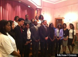 D.C. Mayor Vincent Gray stands with members of the D.C. Youth Advisory Council on Tuesday night at the Charles Sumner School Museum and Archives.