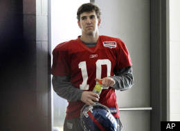 New York Giants quarterback Eli Manning enters the practice field after leaving momentarily during NFL football practice, Wednesday, Jan. 18, 2012, in East Rutherford, N.J. Manning missed part of the practice session with a stomach illness. The Giants travel to San Francisco to play the 49ers in the NFC championship game. (AP Photo/Julio Cortez)