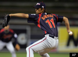 FILE - In this March 17, 2009 file photo, Japan starter Yu Darvish pitches against South Korea in the first inning of their World Baseball Classic game in San Diego. For Yu Darvish and the Texas Rangers, it's deadline day. The AL champion Rangers are at the end of their 30-day negotiating window to agree to a contract with Japan's top pitcher that they bid a record $51.7 million just to talk to. (AP Photo/Chris Park, File),
