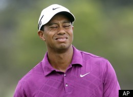 U.S. golfer Tiger Woods reacts to a put on the 3rd green during the first round of the Australian Open golf tournament in Sydney, Australia, Thursday, Nov. 10, 2011. (AP Photo/Rob Griffith)