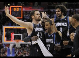 Minnesota Timberwolves forward Kevin Love (42) reacts with guard Wayne Ellington (22) and guard Ricky Rubio (9) of Spain after hitting a three point shot to win the game during the second half of their NBA basketball game against the Los Angeles Clippers, Friday, Jan. 20, 2012, in Los Angeles. The players, second from left and far right are unidentified. The Timberwolves won 101-98. (AP Photo/Mark J. Terrill)