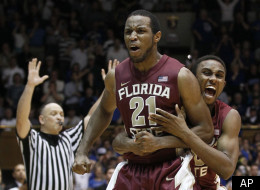 Florida State's Michael Snaer (21) and Ian Miller celebrate Snaer's game-winning basket against Duke during the second half of an NCAA college basketball game in Durham, N.C., Saturday, Jan. 21, 2012. Florida State won 76-73. (AP Photo/Gerry Broome)