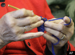 In this Friday, Nov. 11, 2011 photo, Bev Meska of Michigan City, Ind. works on a scarf in Indianapolis. Meska crocheted about 250 scarves for a