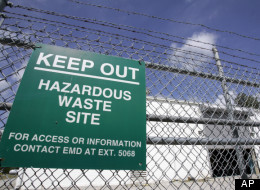A sign is posted at an ongoing cleanup pump and treatment center operated by Shaw Corp. on lot 203 at Camp Lejeune, N.C., Wednesday, May 9, 2007.