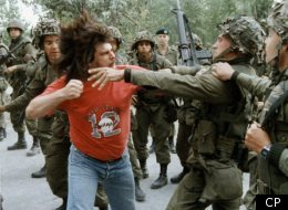 A Mohawk man winds up to punch a soldier during a fight that took place on the Khanawake reserve on Montreal's south shore in 1990.  (CP PHOTO)