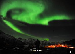 The aurora borealis, or Northern Lights, are seen near the city of Tromsoe, northern Norway, late Tuesday, Jan. 24, 2012. Stargazers were out in force in northern Europe on Tuesday, hoping to be awed by a spectacular showing of northern lights after the most powerful solar storm in six years. (AP Photo/Scanpix Norway, Rune Stoltz Bertinussen)