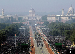 In this hand out picture released by Defense Public Relations office, Indian army soldiers march in formation on Rajpath with Indian presidential palace, center, during the main Republic Day parade in New Delhi, Thursday, Jan. 26, 2012. (AP)