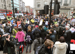 A group of wheelchair bound protesters chain themselves together across Regent Street in Oxford Circus, London