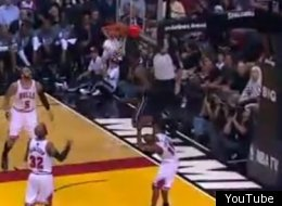 LeBron jumps over a defender for an incredible alley-oop.