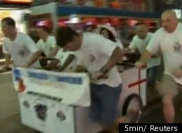 One of 30 teams participating in the fourth annual Pattaya Bed Race in Pattaya, Thailand. Teams of up to six people have to push a bed one mile in order to win.