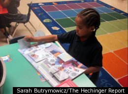 A Lighthouse Academy kindergartener participates in silent reading time. (Photo by Sarah Butrymowicz)