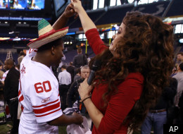 Televisa's Marisol Gonzalez dances with New York Giants' Selvish Capers during Media Day for NFL football's Super Bowl XLVI Tuesday, Jan. 31, 2012, in Indianapolis. (AP Photo/David J. Phillip)