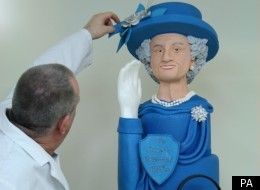 The Queen cake is four feet tall and weighs 15 kilos