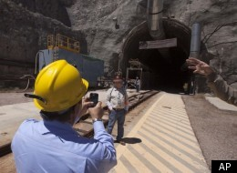 FILE: In this photo taken April 26, 2011, Rep. Michael Burgess, R-Texas, uses his cell phone to take a photo of the entrance to Yucca Mountain in Mercury, Nev. Republicans claim this stark landscape is the nation's best hope for a national nuclear waste dump. But with Democrats running the White House and Senate, the Yucca Mountain nuclear site has been shuttered with no chance of reopening. (AP Photo/Julie Jacobson)