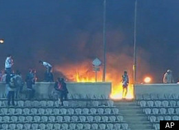 This image made from Egypt TV shows fans and a fire at a soccer stadium in Port Said, Egypt, Wednesday, Feb.1, 2012. Dozens of Egyptians were killed Wednesday in violence following a soccer match in Port Said, when fans flooded the field seconds after the match against a rival team was over, Egypt's Health ministry said. It was one of the worst incidents of sports violence in Egypt in decades. A security official and a medic said fans of the home team, Al-Masry, swarmed the field after a rare 3-