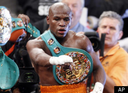 Floyd Mayweather celebrates his victory over Victor Ortiz shortly after their WBC welterweight title boxing match, Saturday, Sept. 17, 2011, at The MGM Grand Garden Arena in Las Vegas. (AP Photo/Eric Jamison)