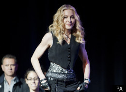 Madonna shows off her muscles and dancing talents at the Super Bowl Halftime Show press conference