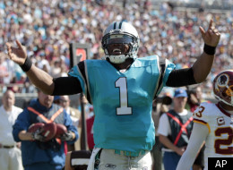 Carolina Panthers' Cam Newton (1) reacts after barely missing a touchdown as Washington Redskins' DeAngelo Hall (23) looks on during the first quarter of an NFL football game in Charlotte, N.C., Sunday, Oct. 23, 2011. (AP Photo/Chuck Burton)
