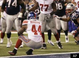 New York Giants running back Ahmad Bradshaw (44) rushes for a touchdown in front of New England Patriots linebacker Jerod Mayo (51) during the second half of the NFL Super Bowl XLVI football game, Sunday, Feb. 5, 2012, in Indianapolis. (AP Photo/Marcio Jose Sanchez)